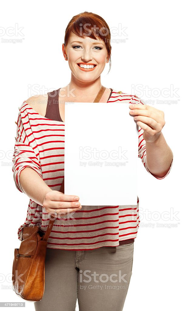Happy student with sheet of paper Portrait of college student showing sheet of paper and smiling at the camera. Studio shot, white background. 18-19 Years Stock Photo
