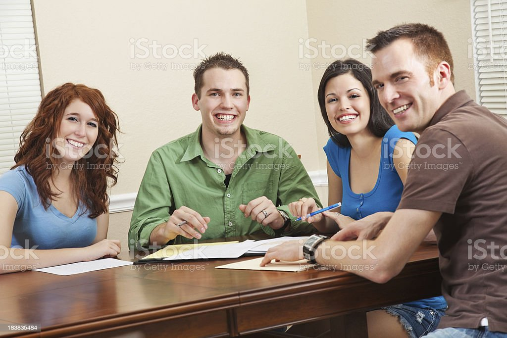 Happy Students At Table Studying Together royalty-free stock photo