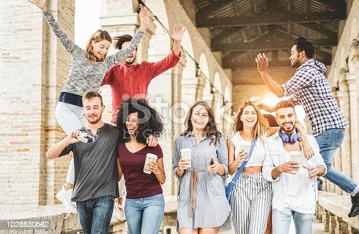 istock Happy students having fun in old city center - Young people at university break enjoying time together - Youth and positive mood with friends concept - Focus on right women holding coffee paper cup 1028830562