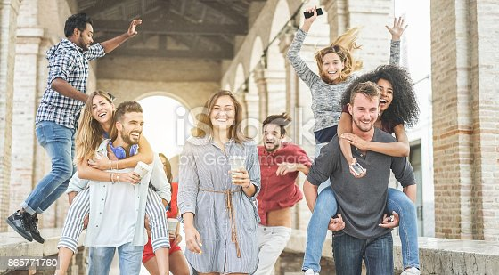 istock Happy students having fun in old city center - Young people at university break enjoying time together - Youth and positive mood with friends concept - Focus on center woman holding coffee paper cup 865771760