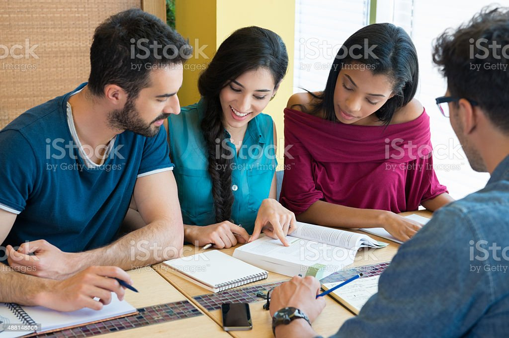 Happy students studying stock photo