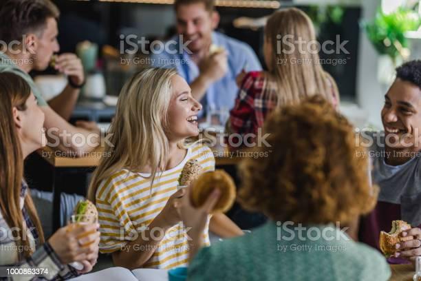Happy students talking while having lunch break at cafeteria picture id1000863374?b=1&k=6&m=1000863374&s=612x612&h=f8hmc4ixmdytv fuwynvps33cgyur5l2n1jbiaa2zu0=