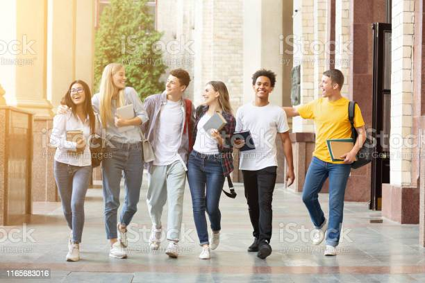 Happy students walking together in campus having break picture id1165683016?b=1&k=6&m=1165683016&s=612x612&h=6foexuu0rsvugtnaf00w temmiyuf8znkajl8 a9w2u=