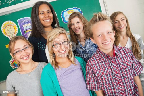 639569206 istock photo Happy Students With Their Teacher in School Classroom 183291128