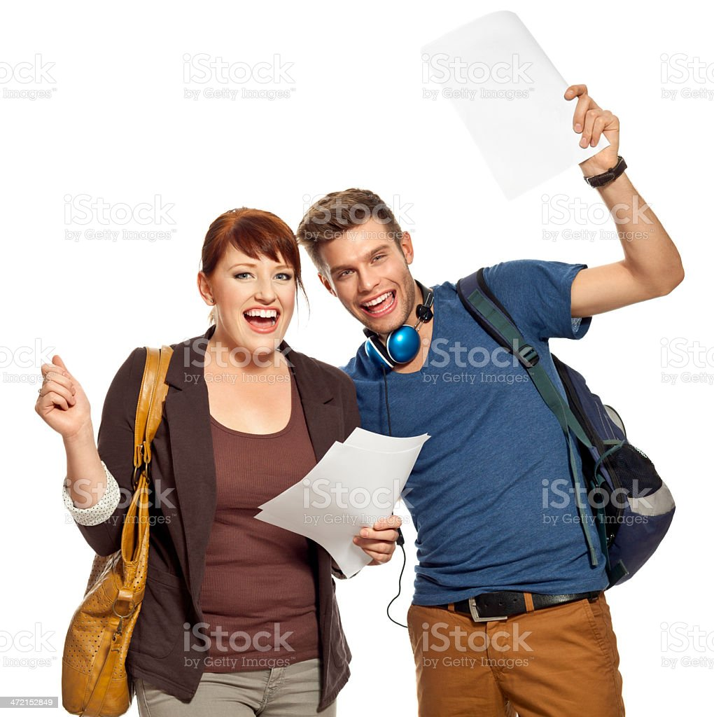 Happy studnets with test results Two happy students enjoying their test results. Studio shot, white background. 18-19 Years Stock Photo