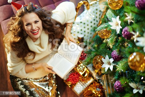istock happy stylish woman reading book 1191927332