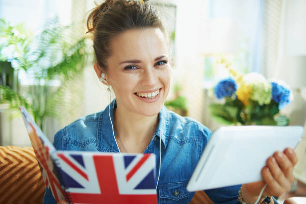 happy stylish woman with tablet PC and notebook learn
