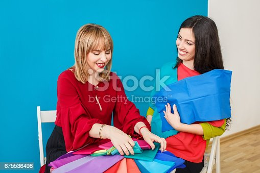 672064598istockphoto happy stylist with client 675536498