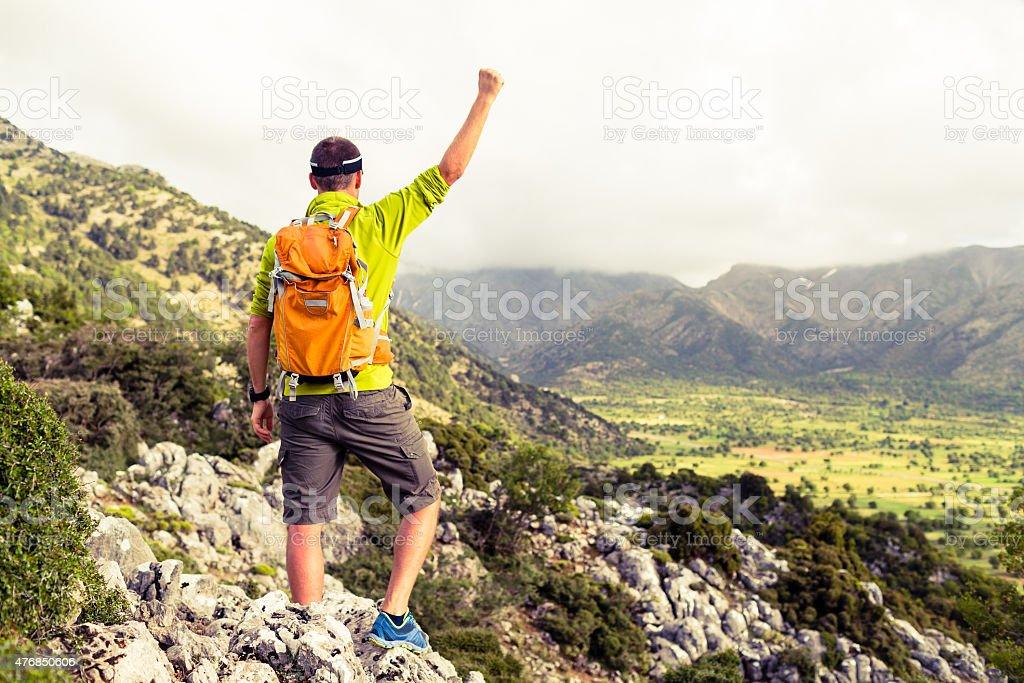 Happy climber hiker winning reaching life goal, success man at...