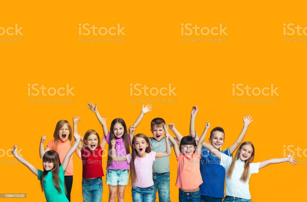 Happy success teensl celebrating being a winner. Dynamic energetic image of happy children stock photo