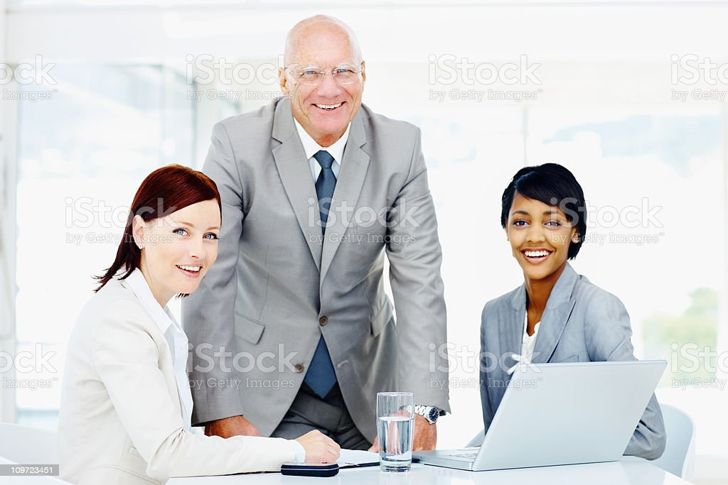 Happy successful business people working on a laptop at office royalty-free stock photo