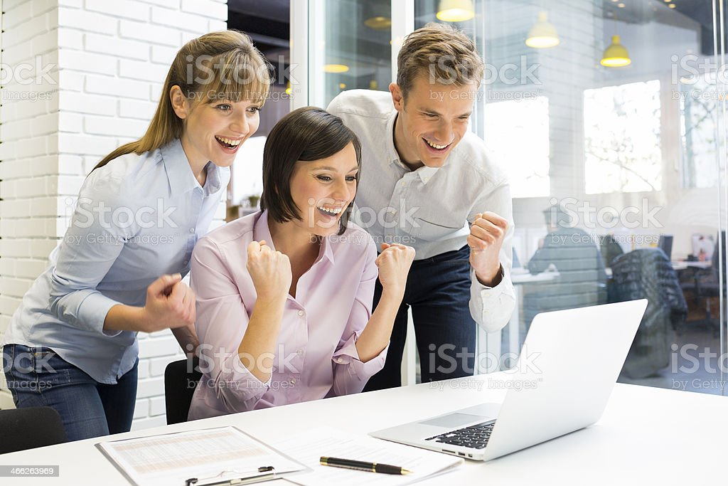 Happy Successful  business team in office, with arms up stock photo