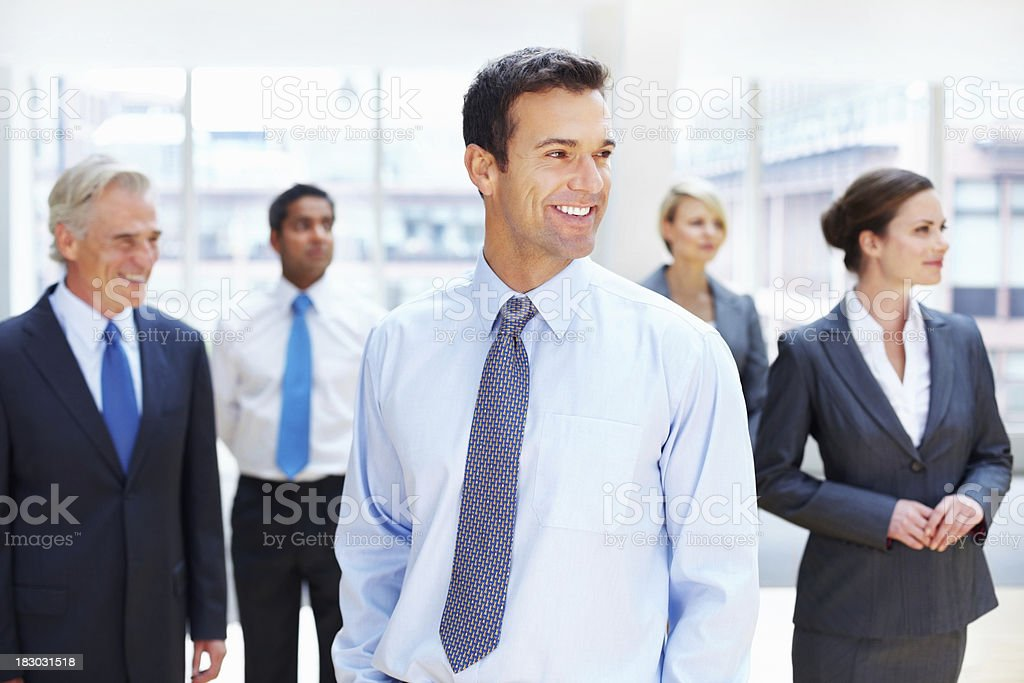 Happy successful business team looking away royalty-free stock photo