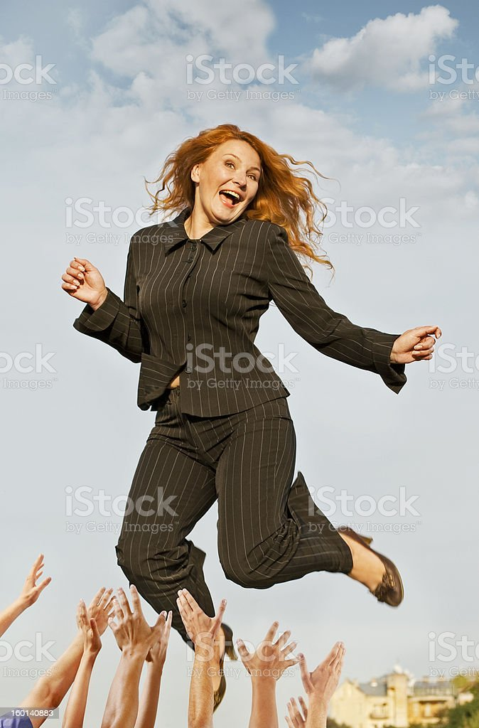 happy successful business woman jumping royalty-free stock photo