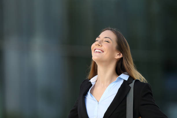 happy successful executive breathing on the street - positive energy stock photos and pictures