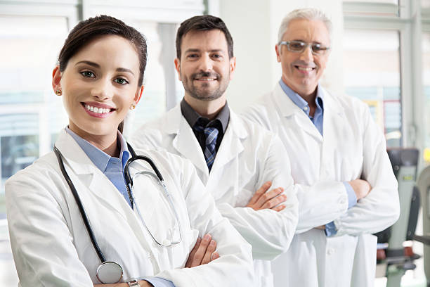Happy successful medical team in a hospital stock photo