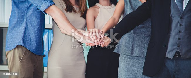 istock Happy Successful multiracial business team giving a high fives gesture as they laugh and cheer their success. 865032294
