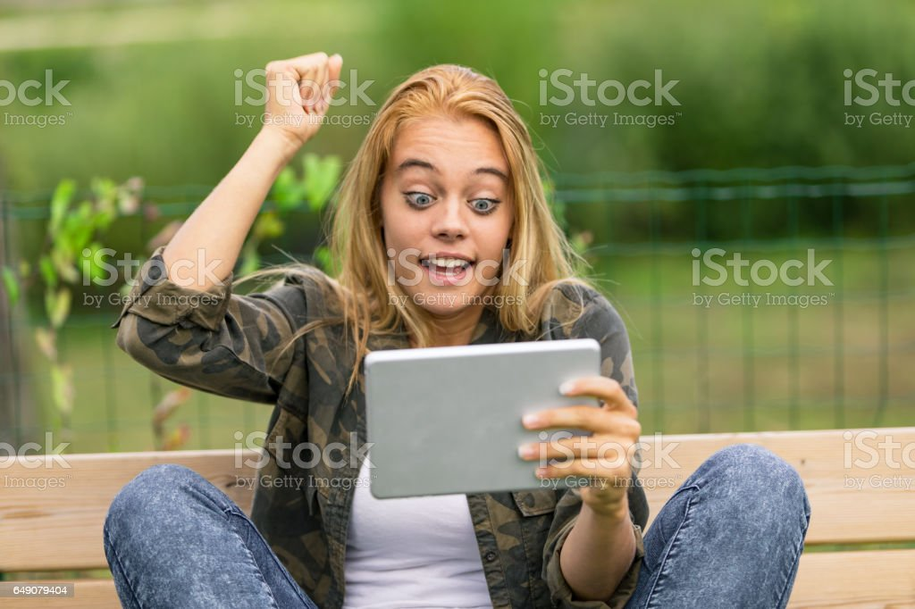 happy surprise for a woman on her social media stock photo