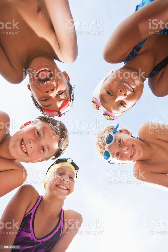 Happy swimmers in a huddle stock photo