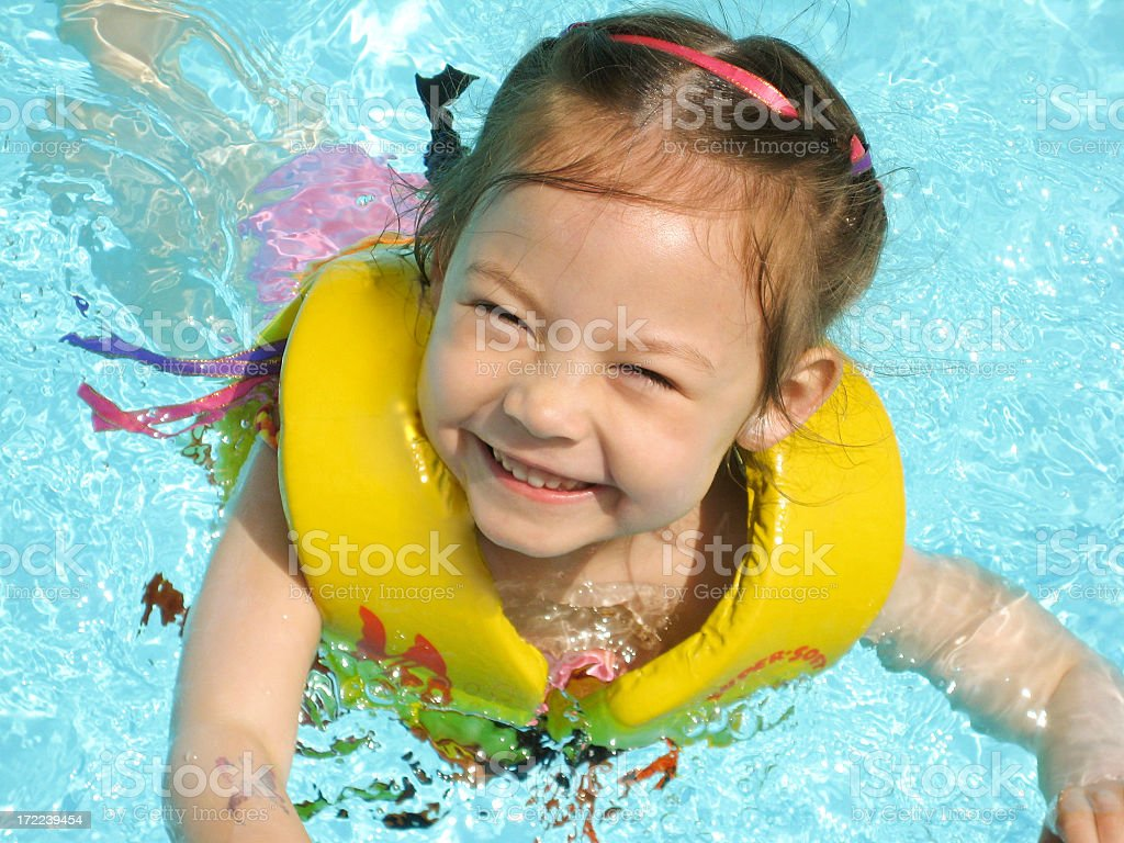 Happy Swimming Girl stock photo
