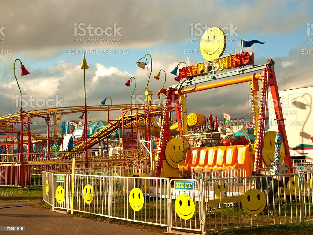 happy swing ride stock photo