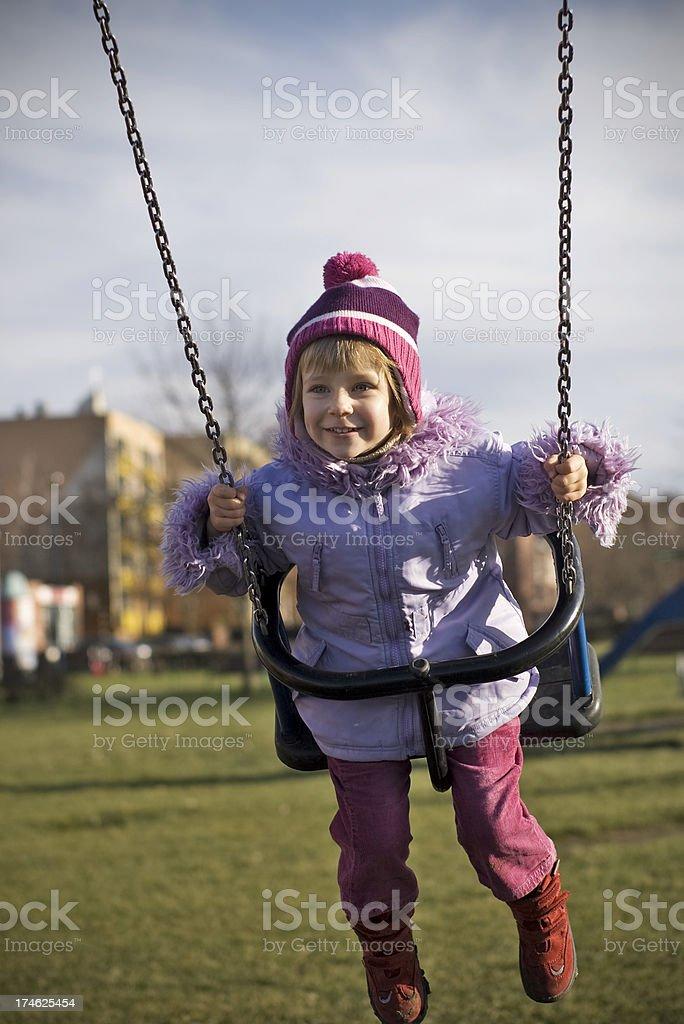 Happy swinging stock photo