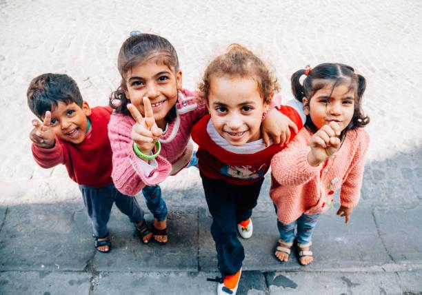 Happy Syrian kids enjoying in Istanbul streets stock photo