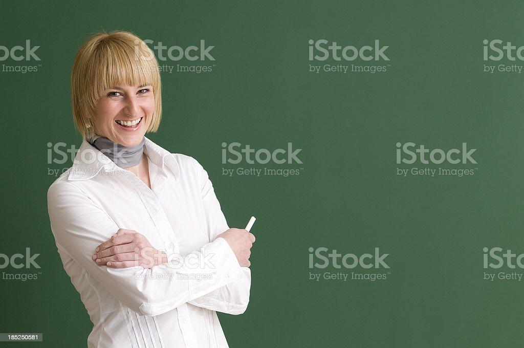 happy teacher holding a chalk stock photo