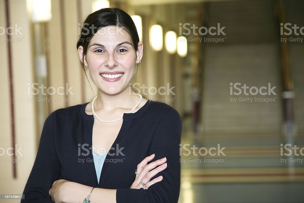 Happy Teacher in the School Hallway royalty-free stock photo
