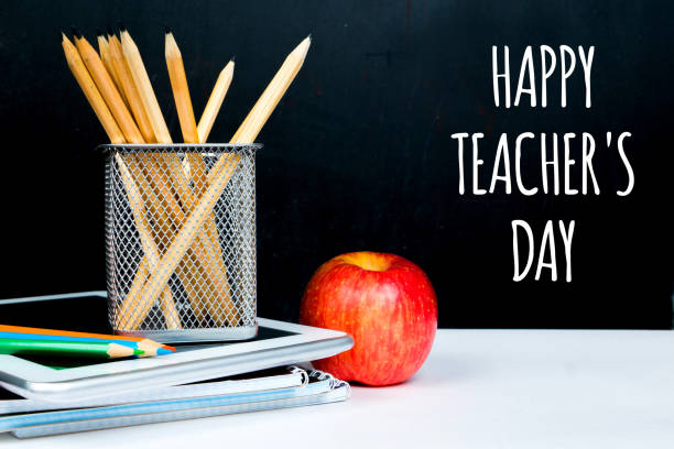 happy teacher's day, chalk greetings on black board in classroom - teachers day stock photos and pictures