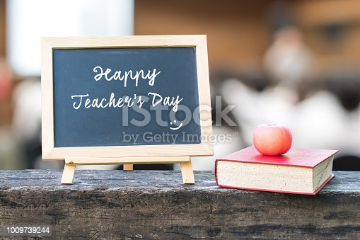 istock Happy teacher's day greeting on black chalkboard background for education concept 1009739244
