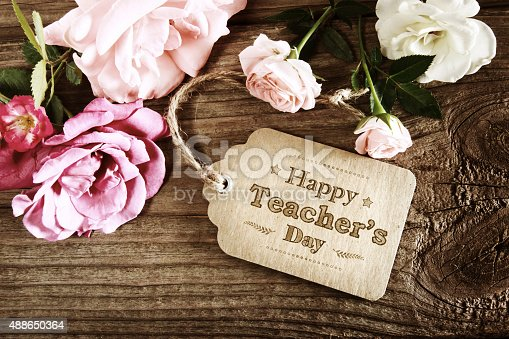 istock Happy Teachers Day message card with small roses 488650364