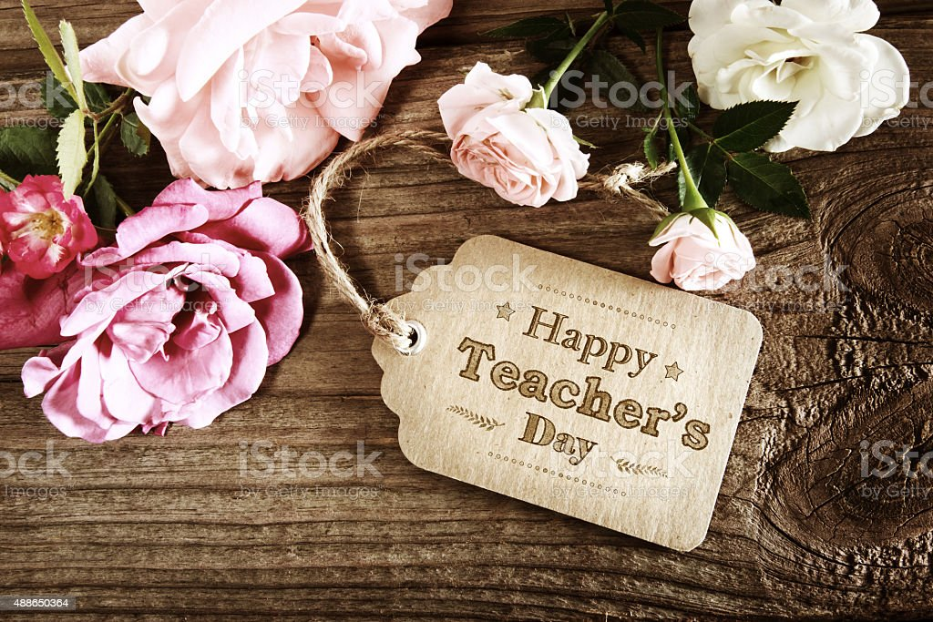 Happy Teachers Day message card with small roses stock photo