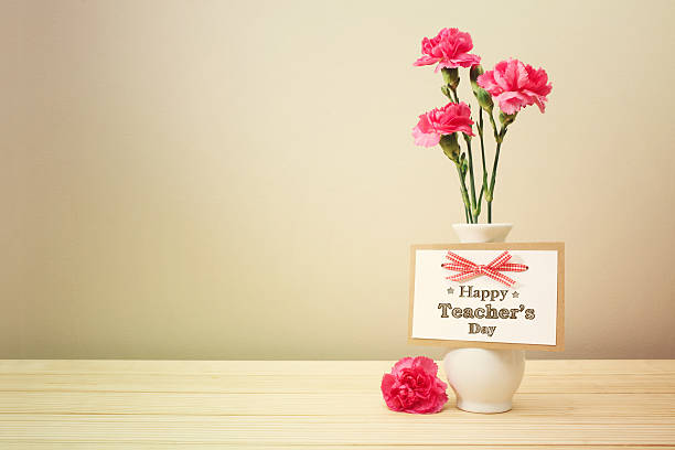 happy teachers day message with carnations - teachers day stock photos and pictures