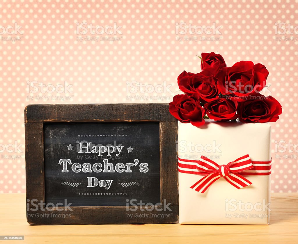 Happy Teachers Day message with gift box and red roses stock photo