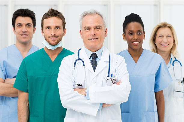 happy team of doctors - female nurse stock photos and pictures