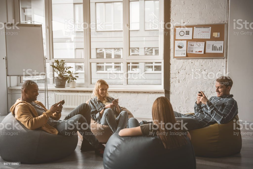 Happy team relaxing at work stock photo