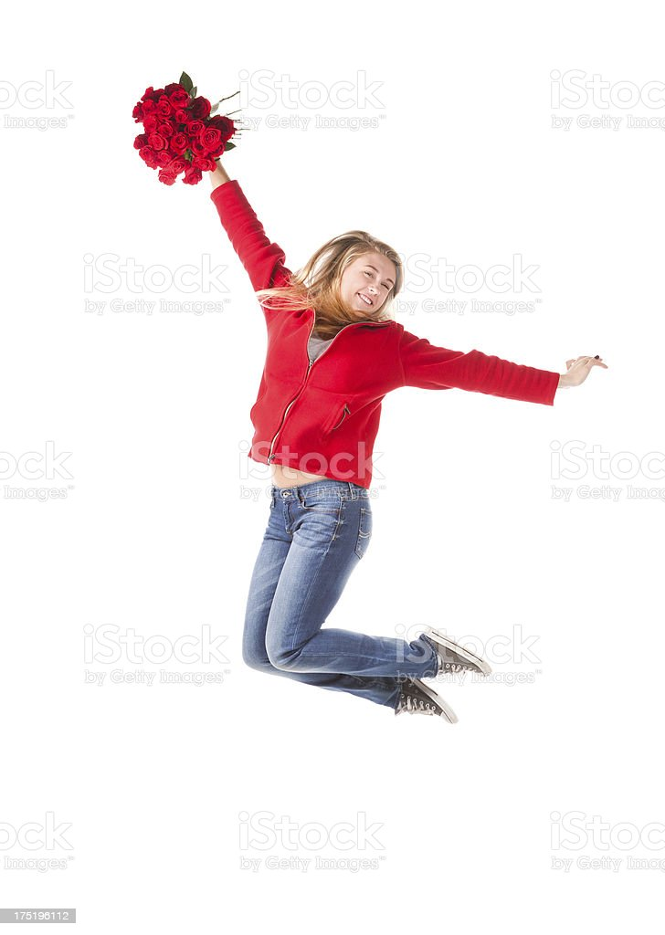 Happy Teen Girl Jumping with Roses on White Background royalty-free stock photo