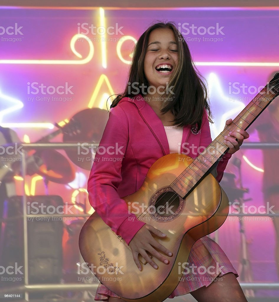 Happy teen girl with guitar - Royalty-free Bright Stock Photo