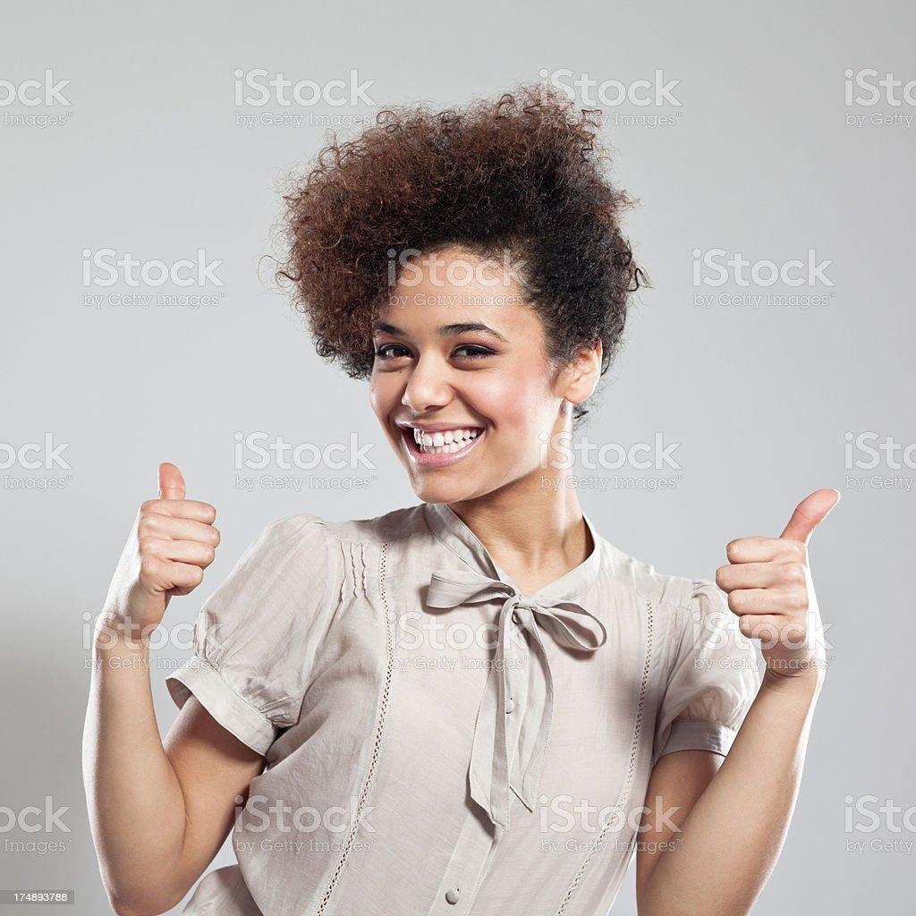 Happy Teen Girl with thumbs up royalty-free stock photo