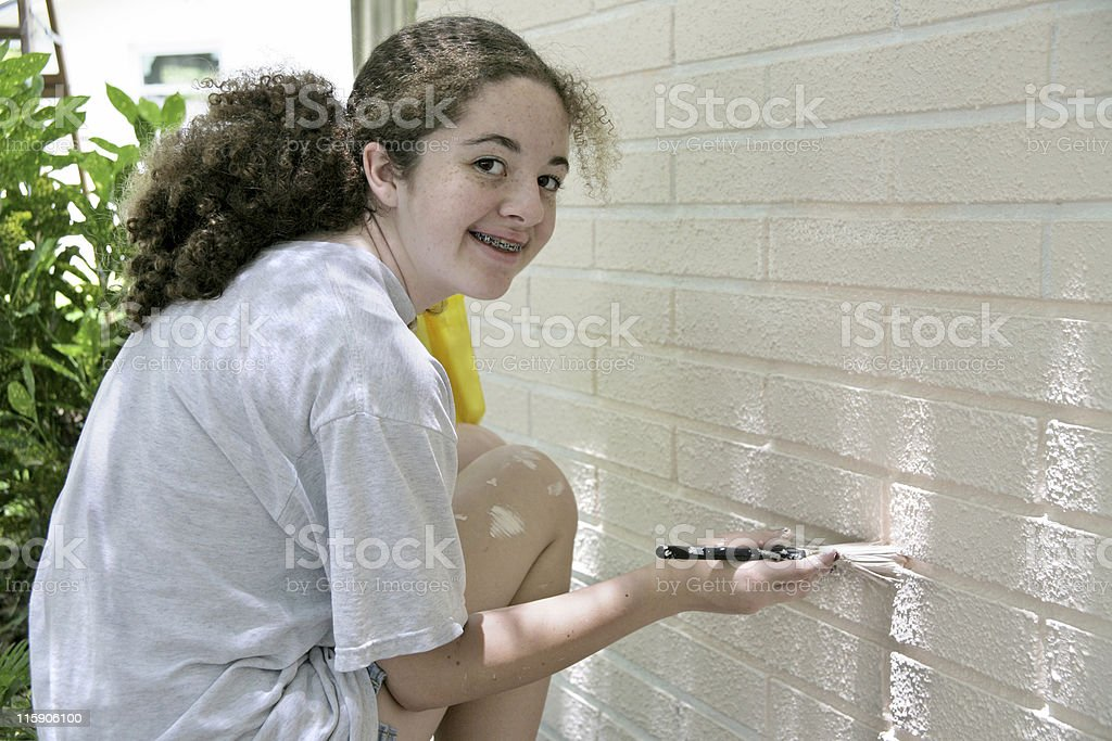 Happy Teen Painting House royalty-free stock photo