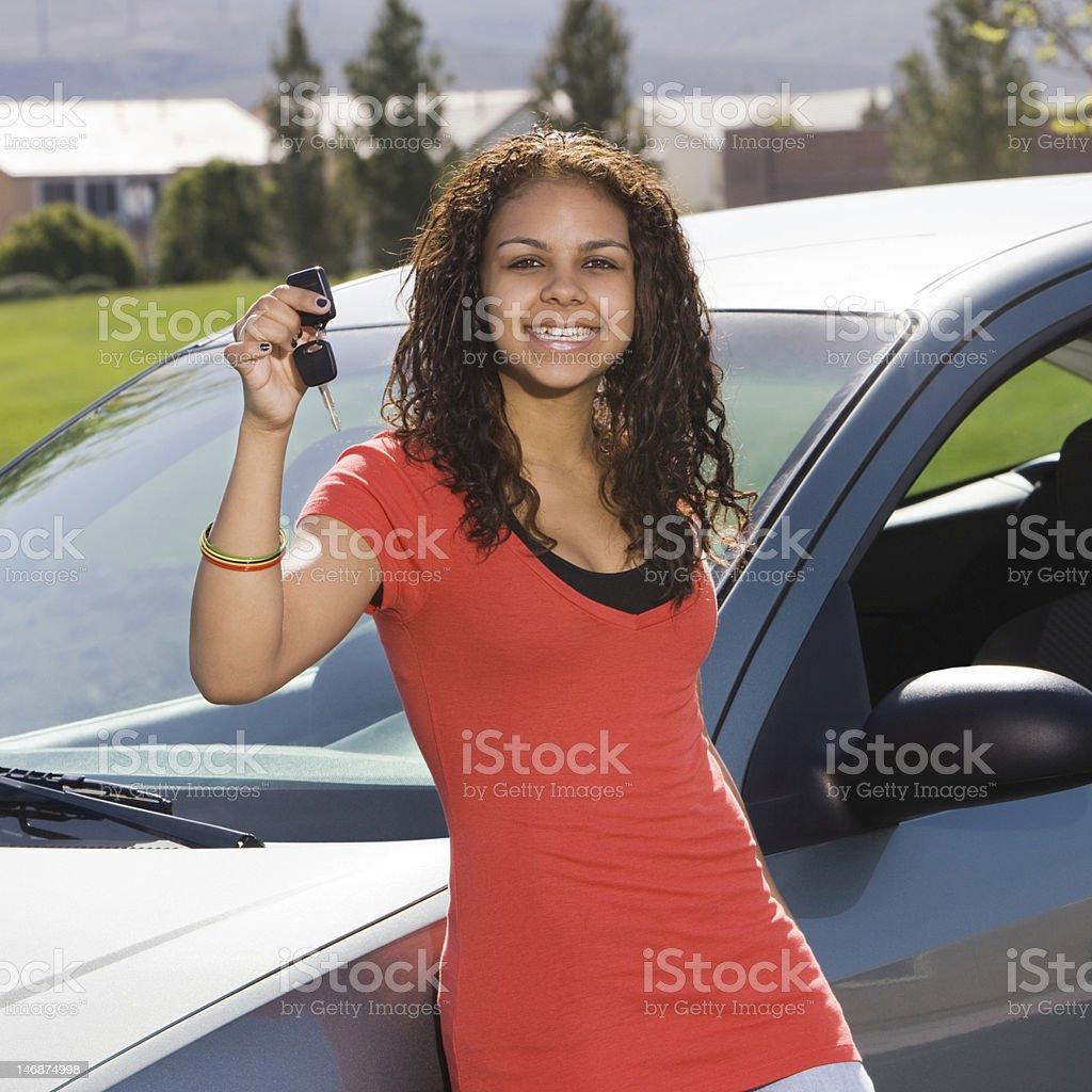 Happy teen with keys to car stock photo