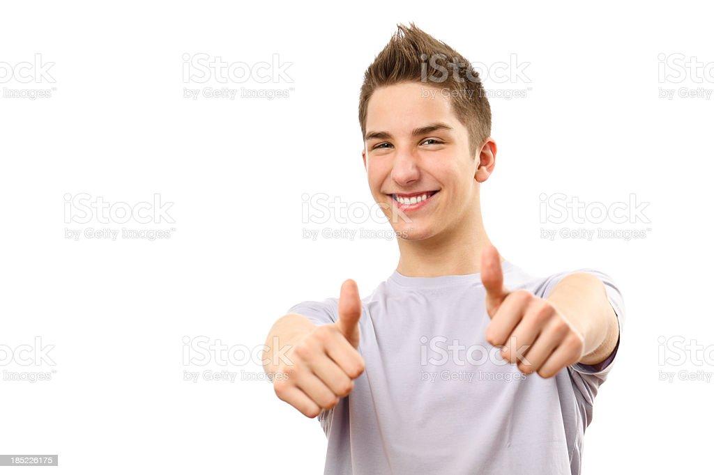 Happy teenage boy showing thumb up royalty-free stock photo