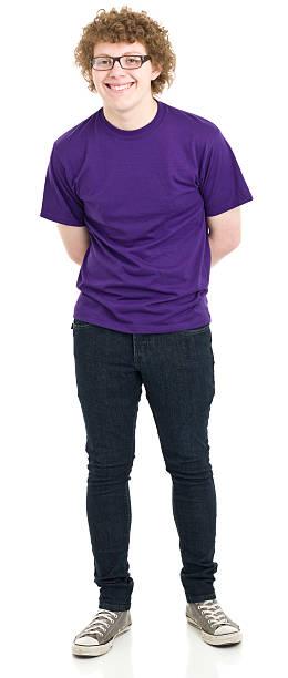 glücklich teenager junge stehend porträt - geek t shirts stock-fotos und bilder
