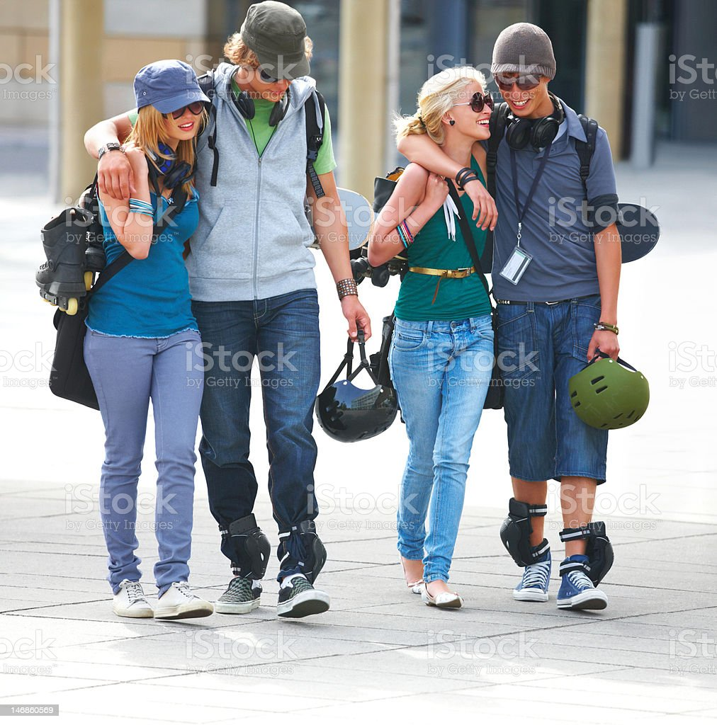 Happy teenage couples walking together on street royalty-free stock photo