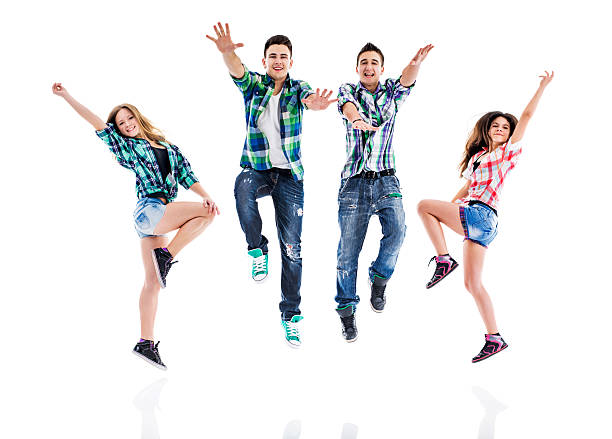 happy teenage dancers jumping while dancing. - dance group stock photos and pictures