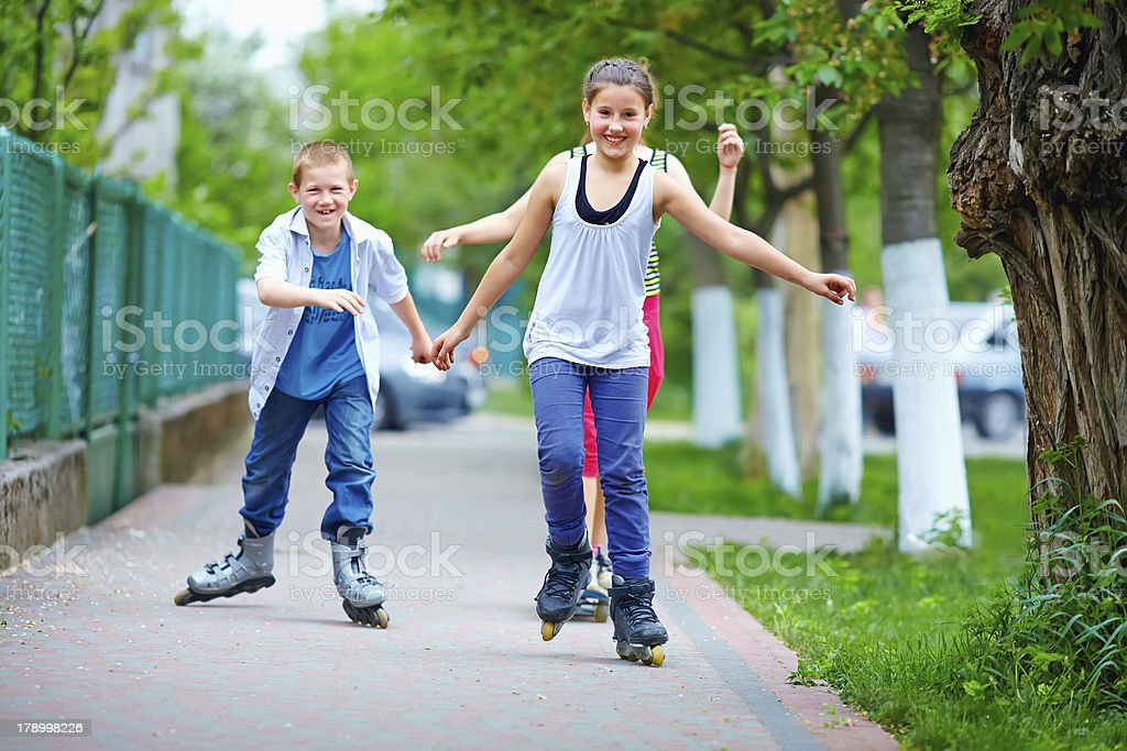 happy teenage friends playing outdoors royalty-free stock photo