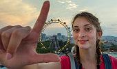 Happy teenage girl in amusement park
