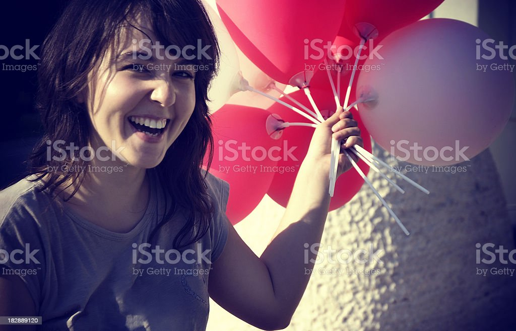 Happy teenage girl with ballons royalty-free stock photo
