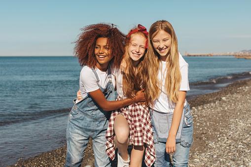 Happy teenage girls on holidays